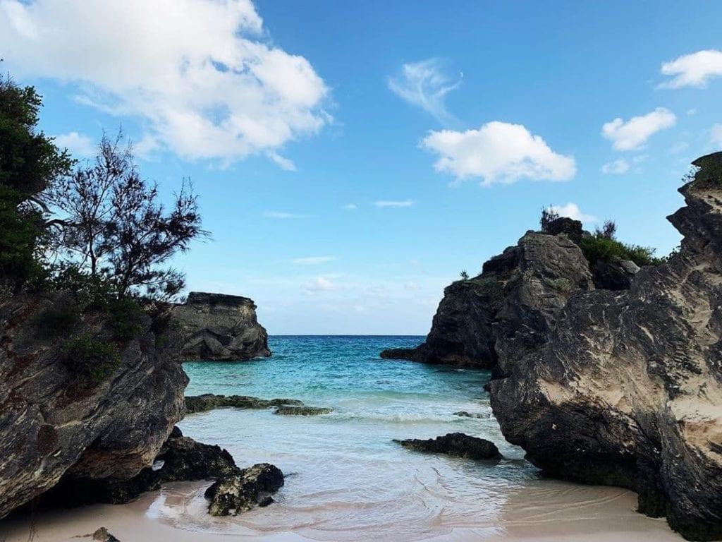 Looking between rocks over the ocean at Horseshoe Bay beach, Bermuda