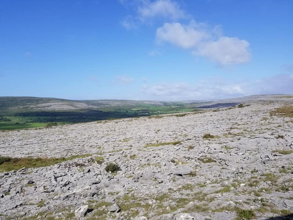 Lunar landscape of the Burren, Ireland with blue skies in County Clare.