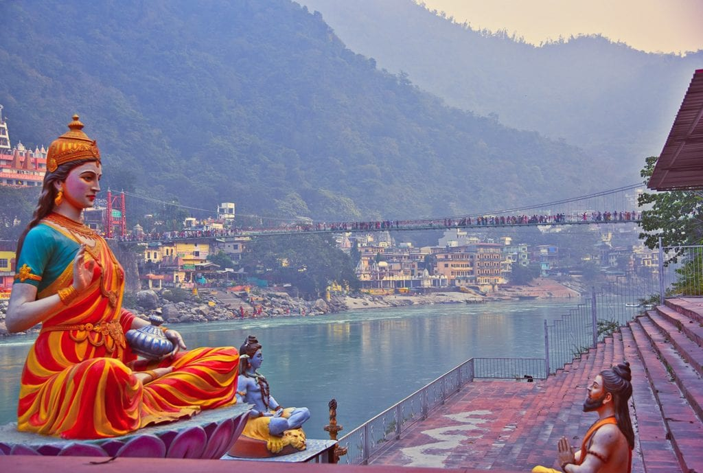 A Hindu statue sits on the banks of the Ganga river in Rishikesh, India, the Yoga Capital of the World.