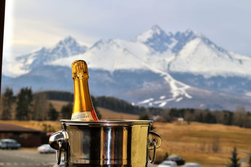 Close up of chilling bottle of champagne with the Tatra mountains in the background Slovakia bucket list