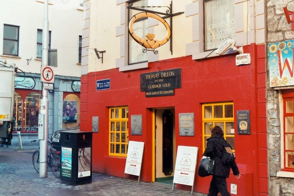 Outer red facade of Thomas Dillon's Claddagh Gold shop, where you can purchase an original Claddagh ring in Galway, Ireland.