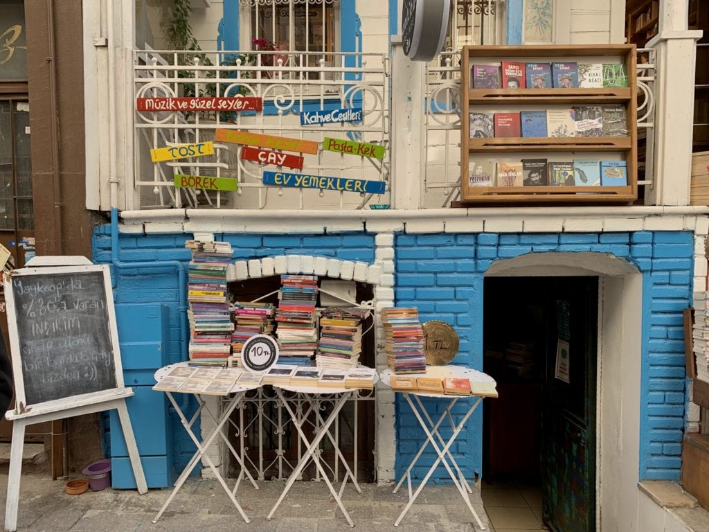 Antique store in Istanbul with stacks of books on a table.