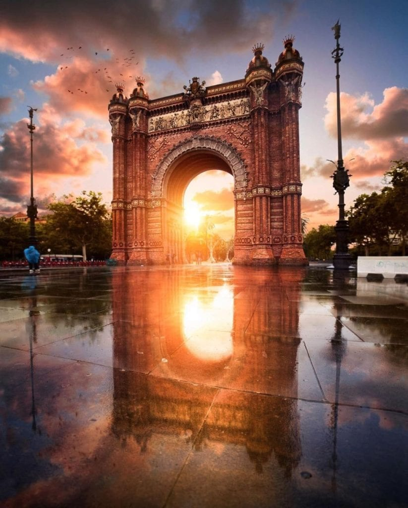 Arc of Triumph in Barcelona with the sun brightly shining through the arch, one of the most beautiful places in Barcelona.