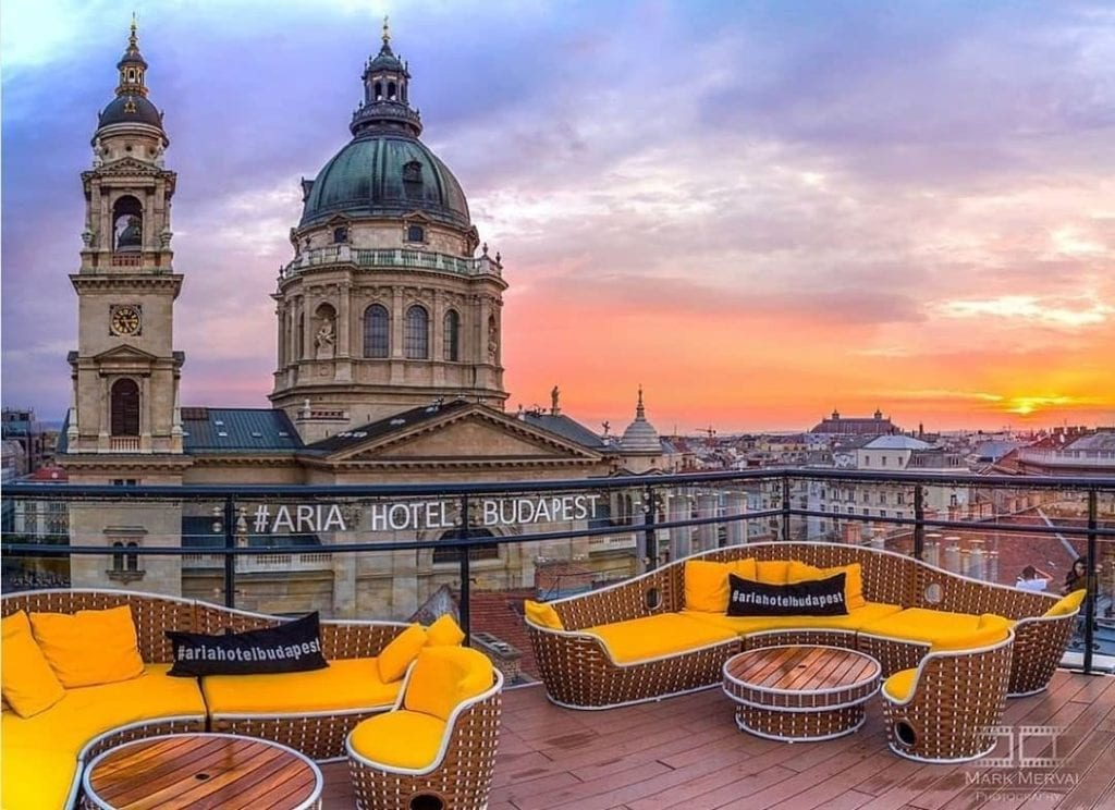Rooftop Aria hotel in Budapest showing the city's skyline during sunset.