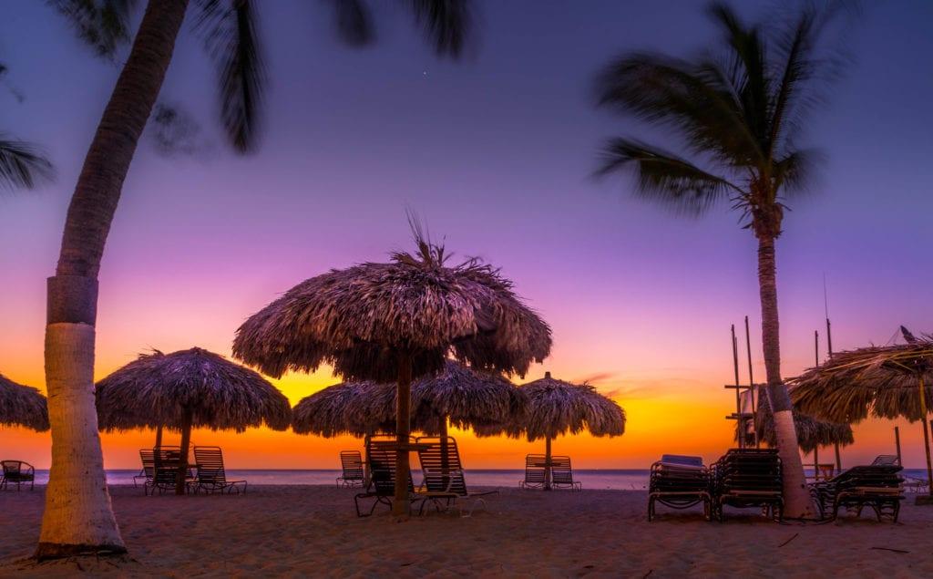 Sunset on an Aruba beach, one of the best yoga destinations around the world.