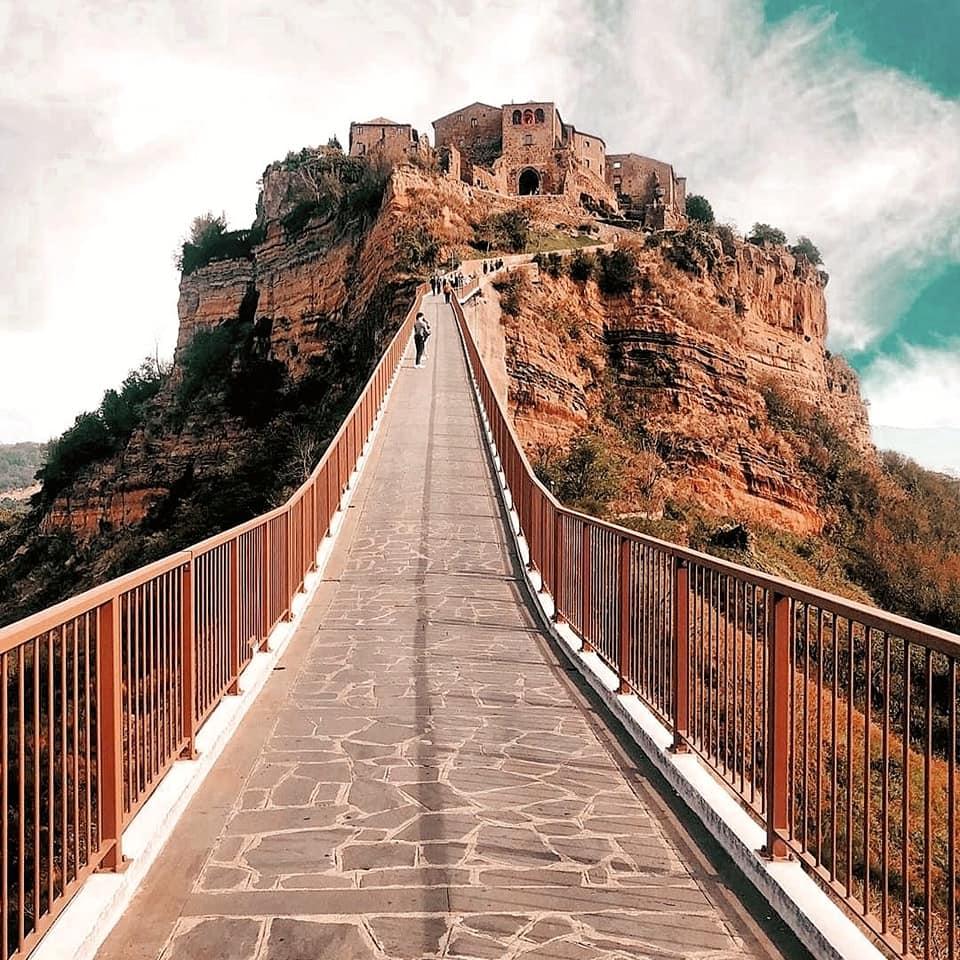 Pedestrian path leading up to Civita di Bagnoregio, the 'dying city' on top of tufo cliffs in Tuscia.