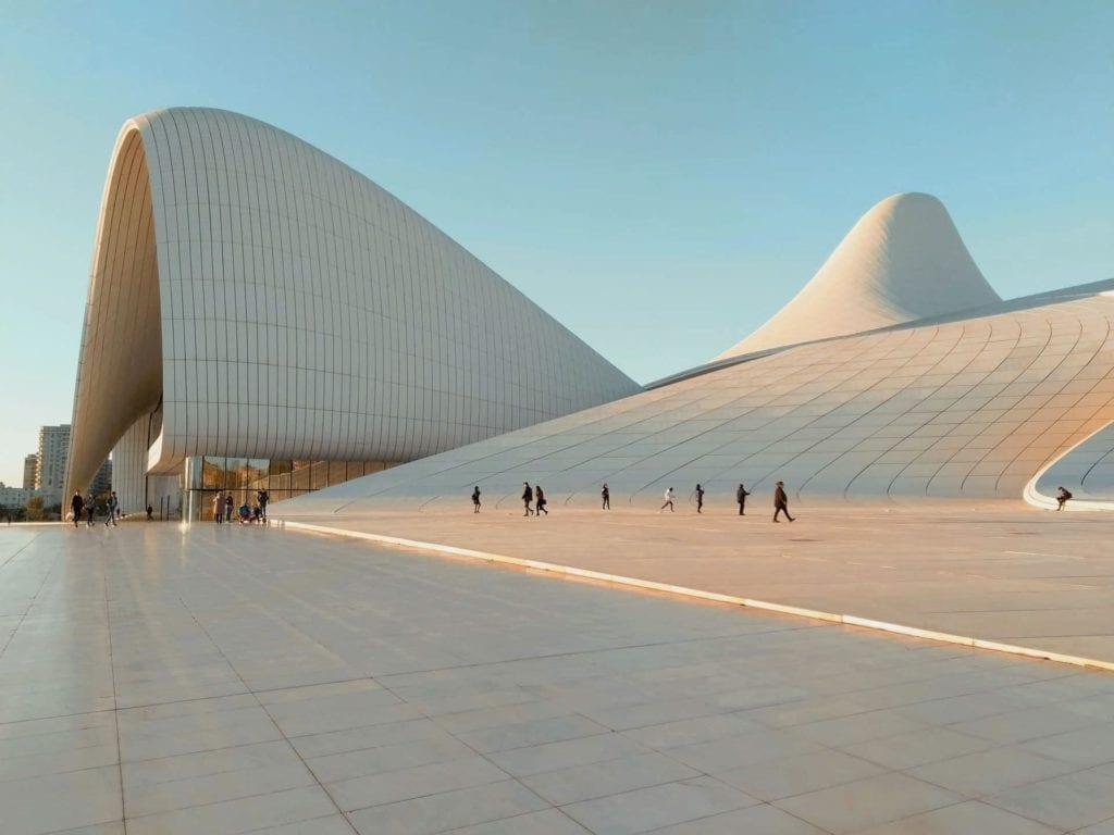 Heydar Aliyev Center in Baku, with people walking around outside.