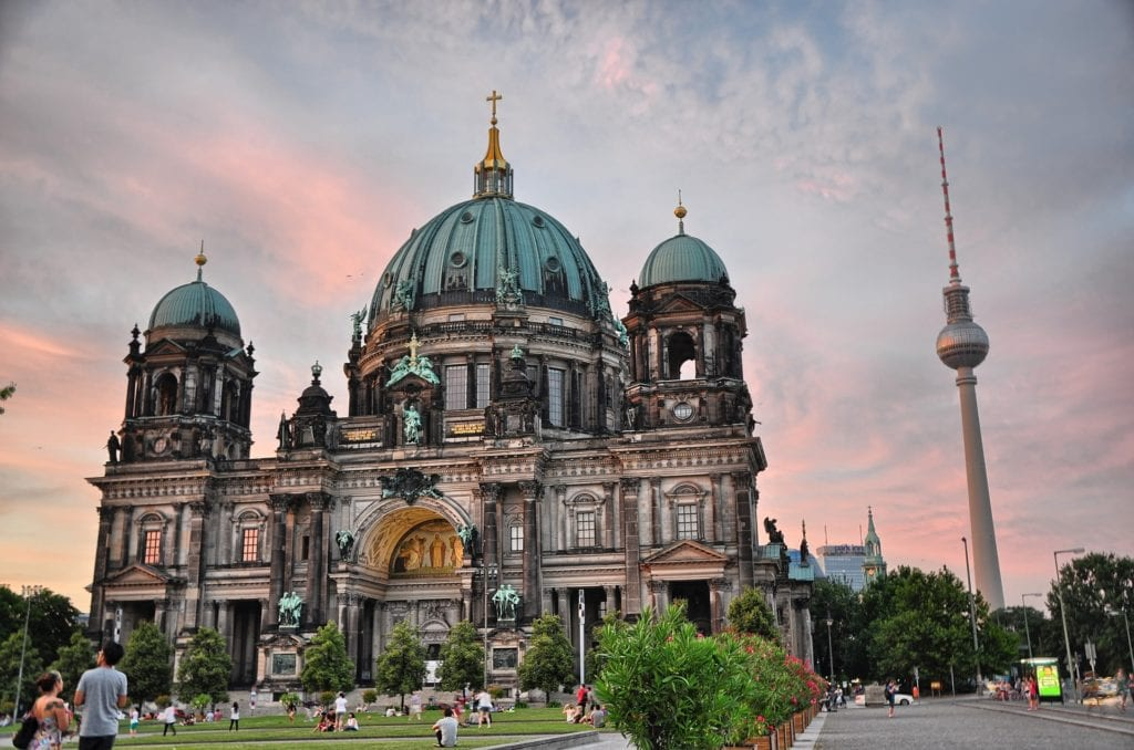 Magical places to visit in Germany - Berlin Cathedral, with its sea green domes and a cotton candy sky in the background.