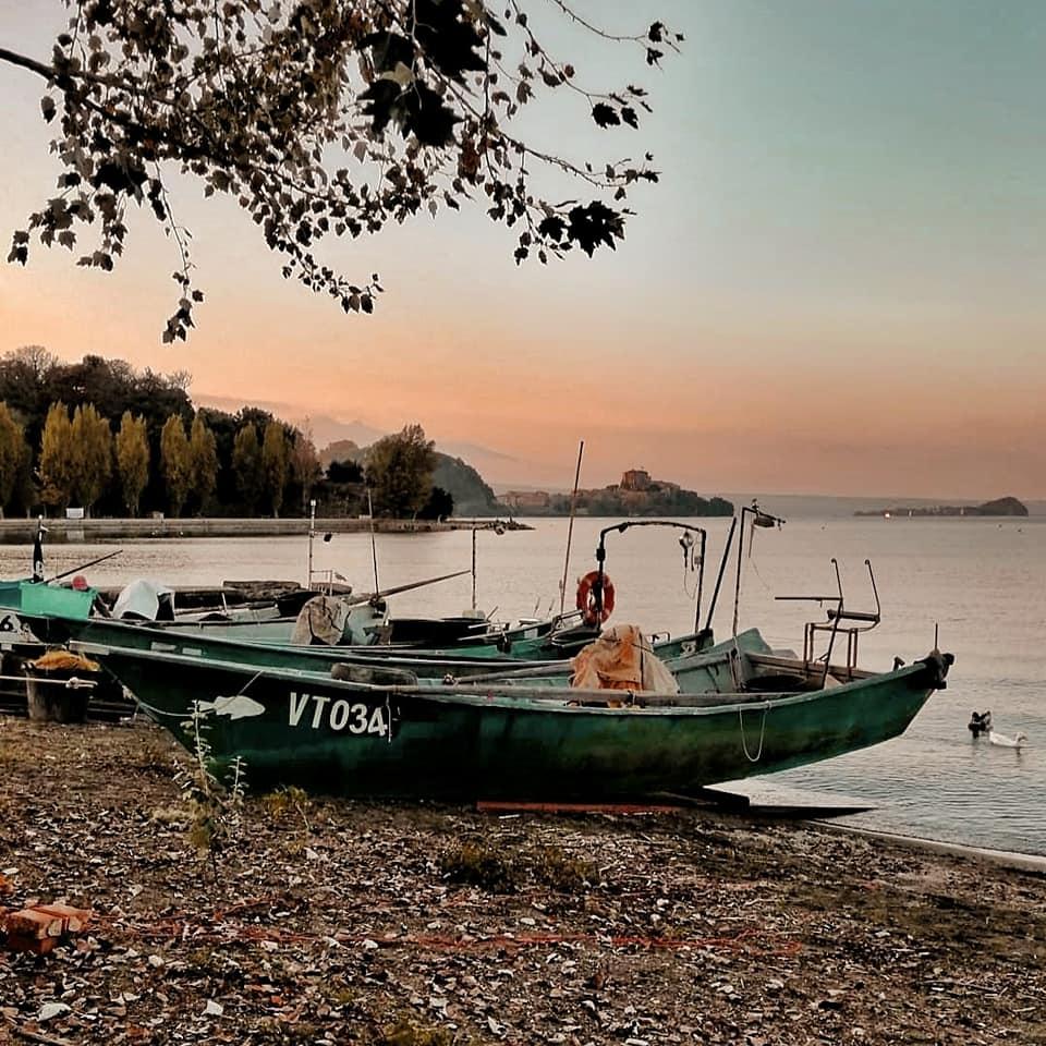 Boats pulled up on shore on lake Bolsena in Tuscia