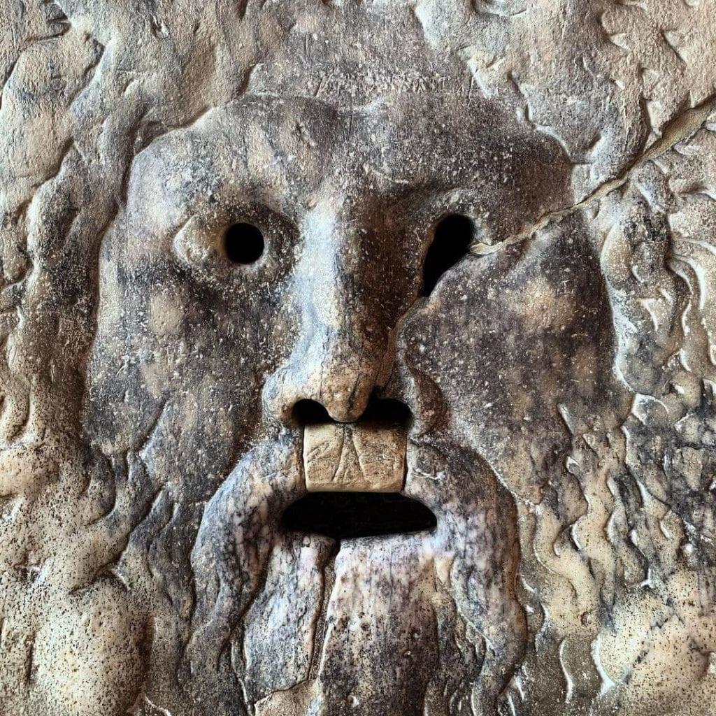 Close-up of the Bocca della Verita (Mouth of Truth) Stone disc in Rome.