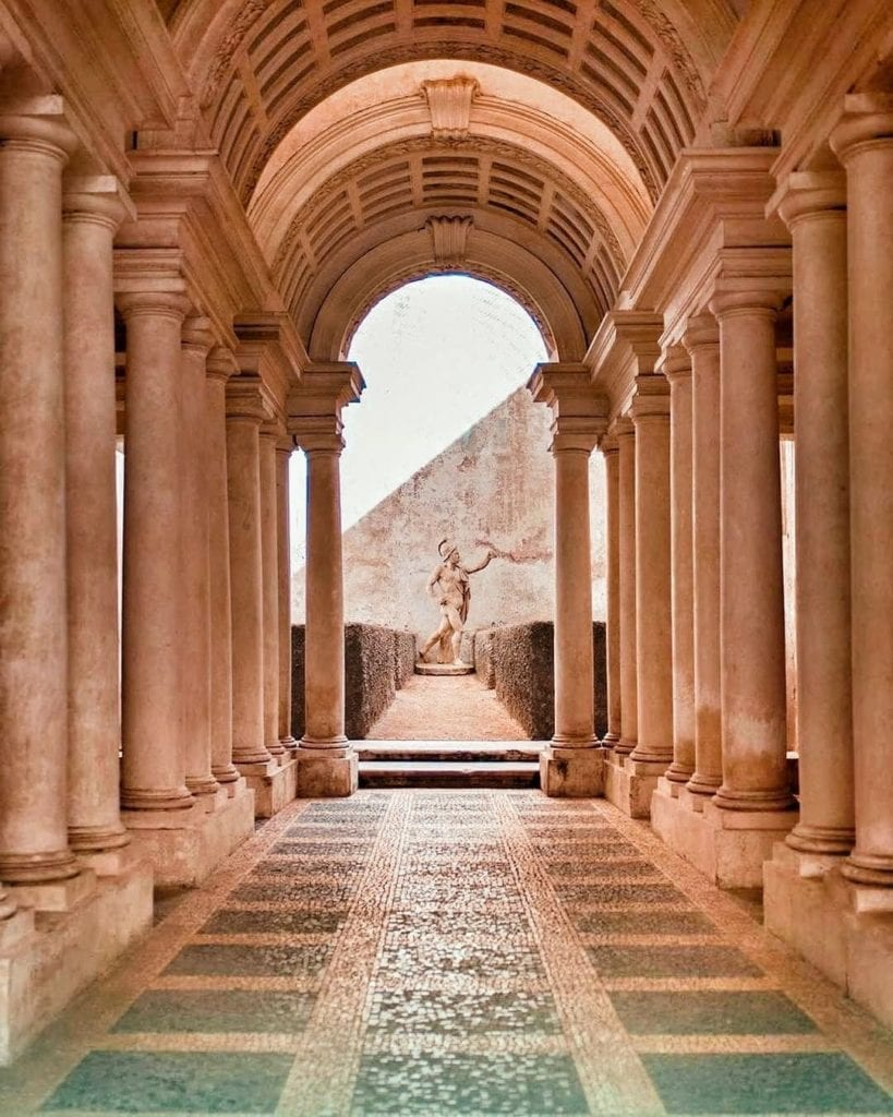 Looking down Borromini's Perspective Corridor in Rome, Italy - one of the city's most Instagrammable places