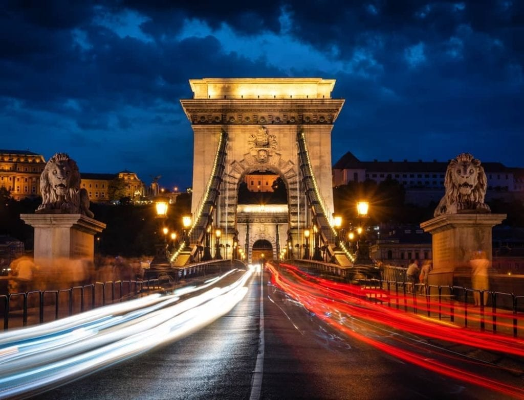Blurred lights of car's tail and headlights as they drive by on Budapest's Chain Bridge, one of the most beautiful places in Budapest.