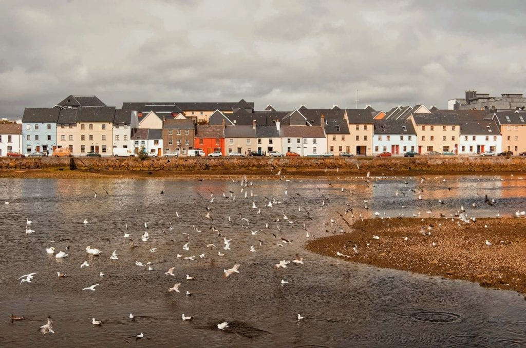 Colorful houses in the Claddagh seen from the Long Walk in Galway City, Ireland.