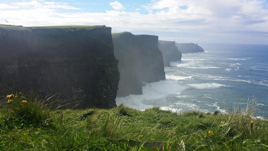 Cliffs of Moher with mist rising off seas.