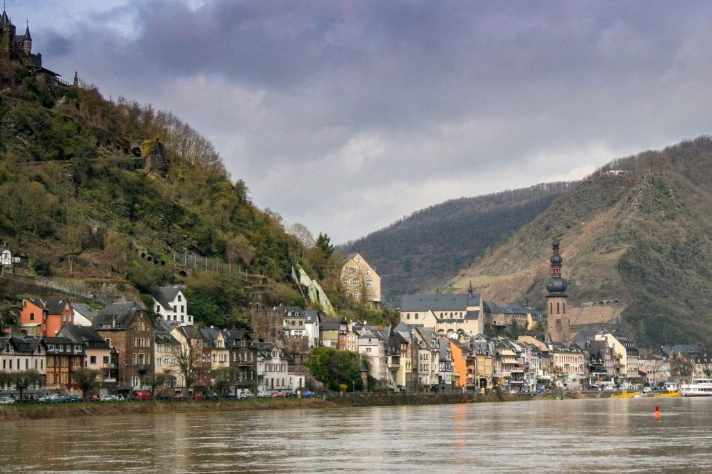 The magical town of Cochem in Germany, set along a river with a castle perched up on a mountain.