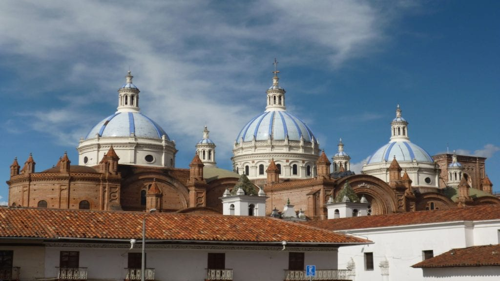 Iconic blue domes of the Immaculate Conception Cathedral in Cuenca, Ecuador, one of the best things to do in Cuenca.
