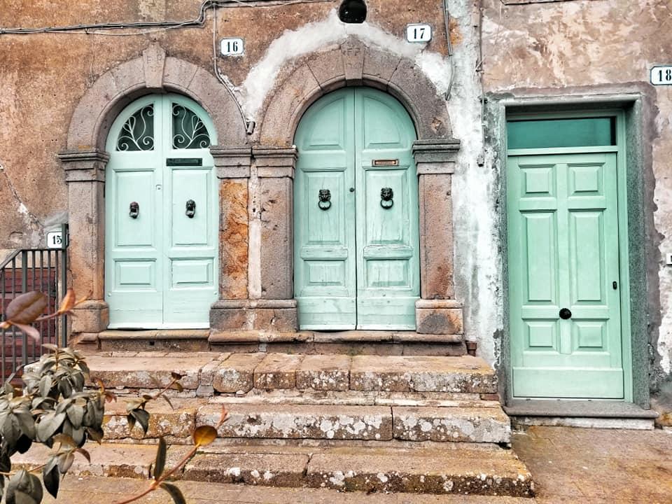 Turquoise doors in Oriolo Romano, Italy.
