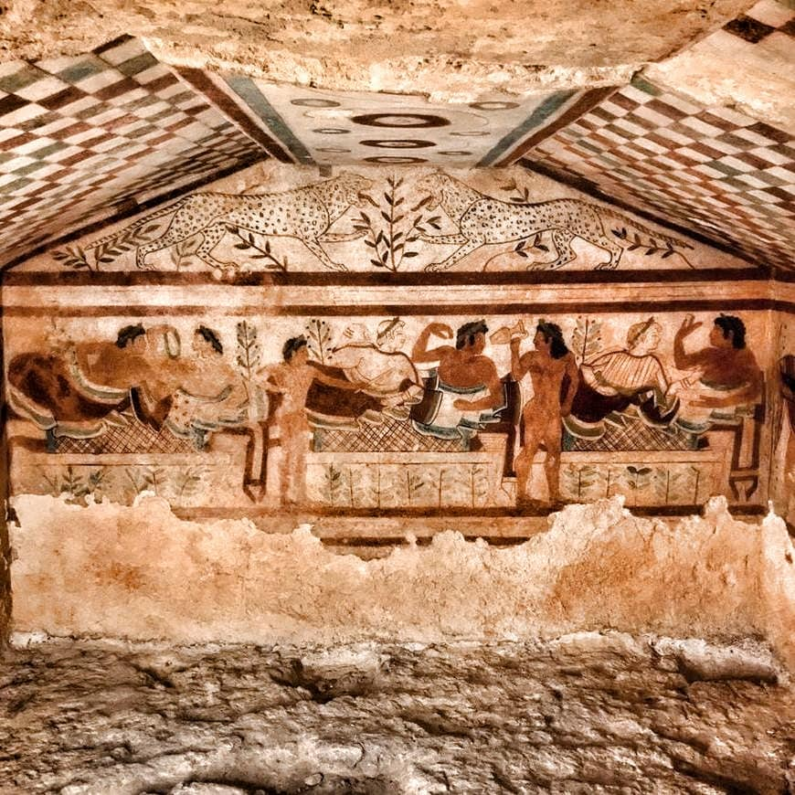 Etruscan paintings in a cave in Tarquinia, one of the hidden gems of Tuscia