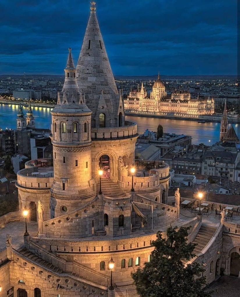 Fisherman's Bastion, looking like something out of a Cinderella movie, with Budapest Parliament seen across the Danube.