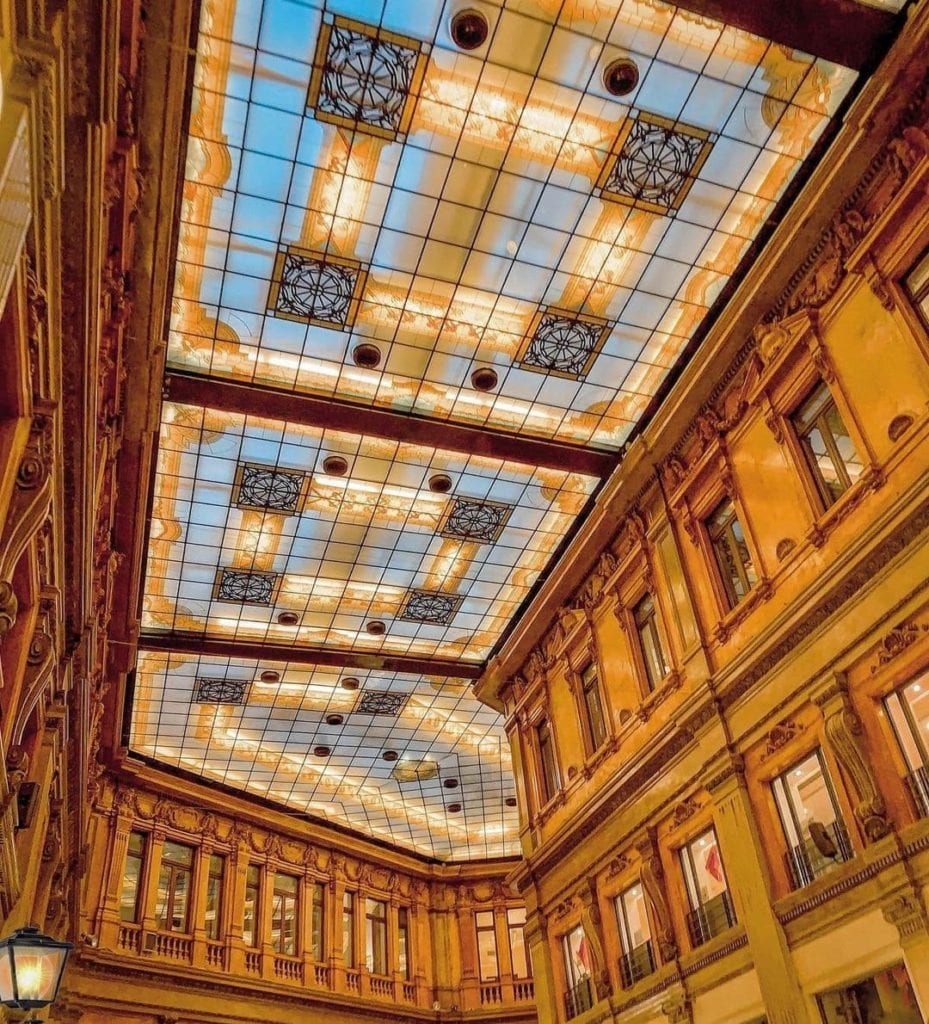Glass art nouveau ceiling of Galleria Alberto Sordi, a shopping arcade in Rome.