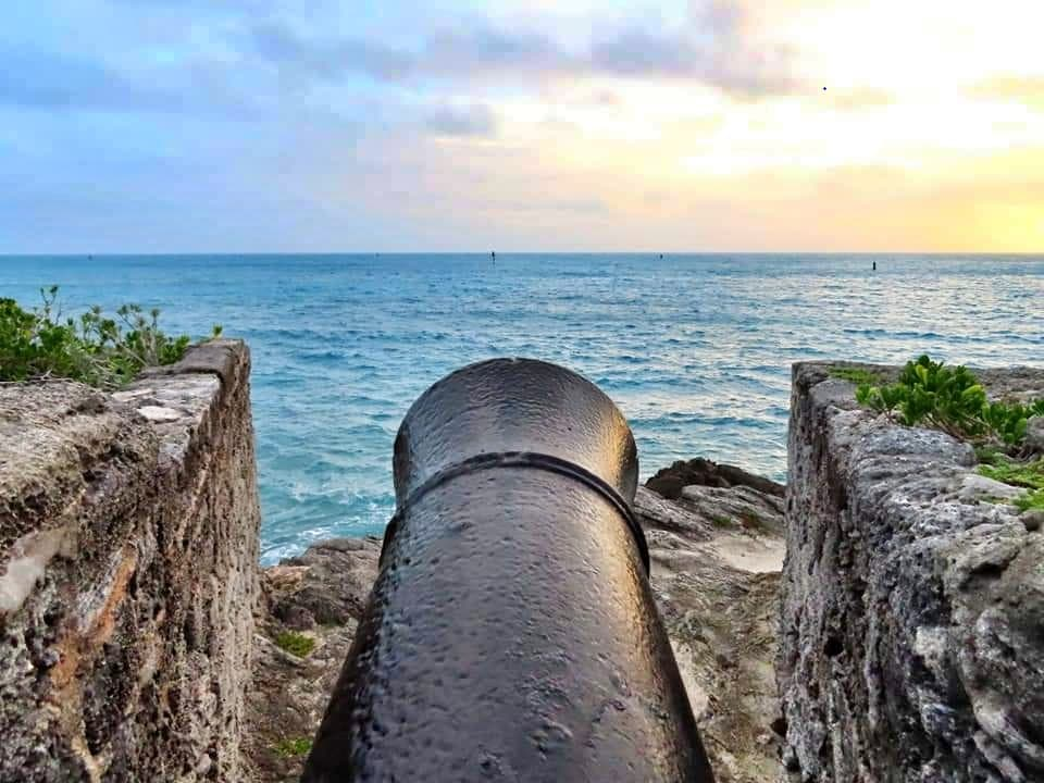 Sitting atop a cannon overlooking the sunrise at Gates' Fort in St. George's, Bermuda