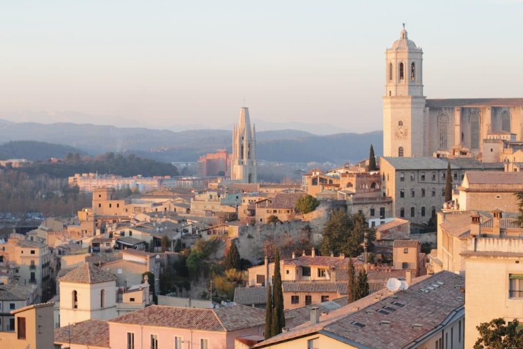 Pastel-hued building tops in Girona, Spain, one of the best day trips to take from Barcelona.