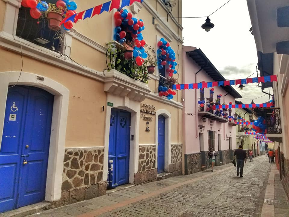 La Ronda in Quito, Ecuador decorated in red and blue flags and balloons for Fiestas de Quito