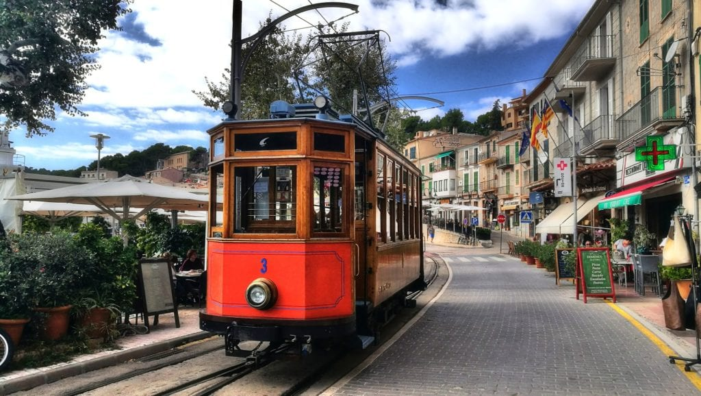 Red trolley on the streets of Mallorca, Spain.