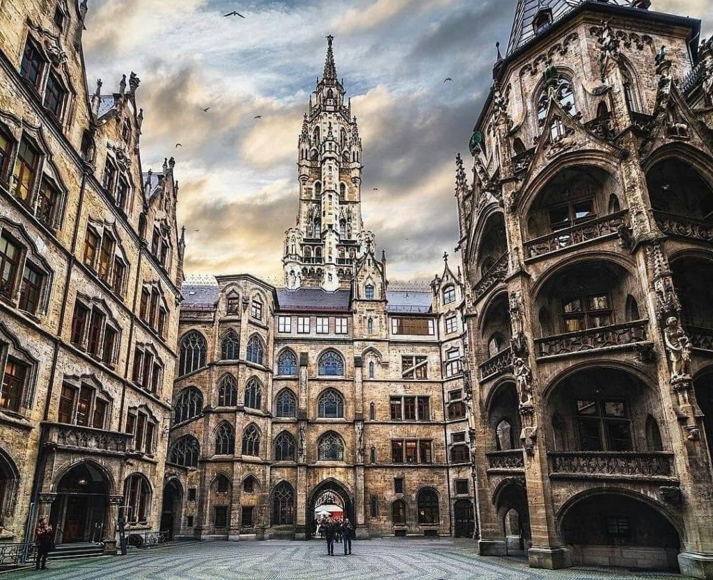 An empty Marienplatz in Munich, Germany with cloudy skies.