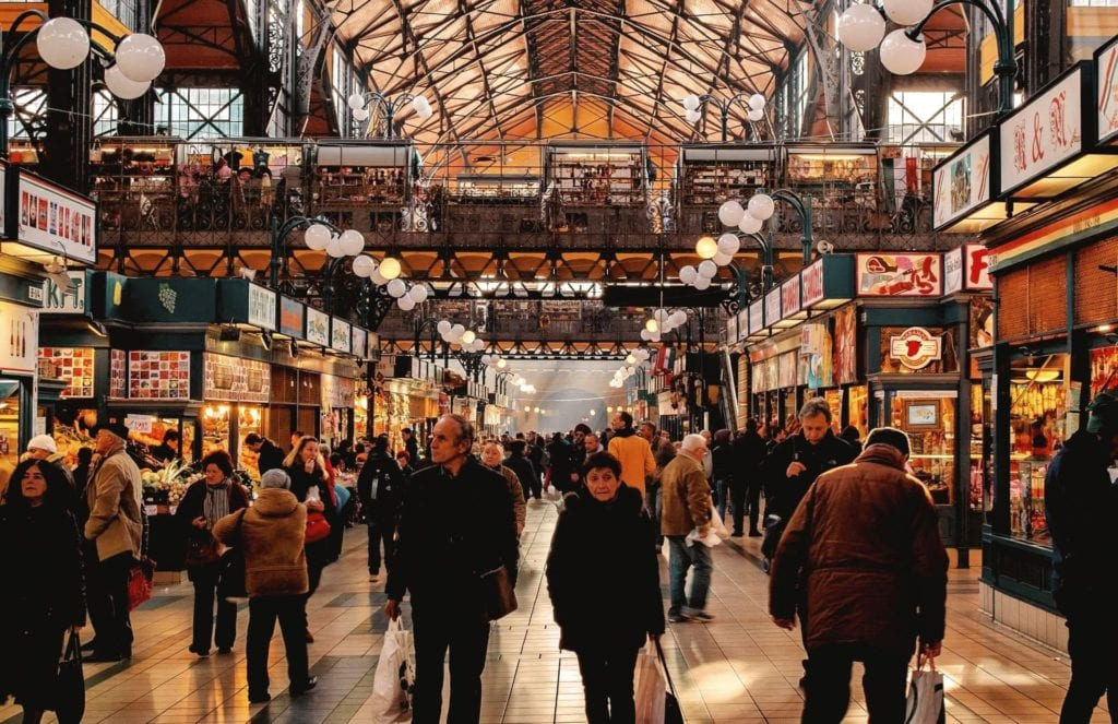 Great Market Hall in Budapest with many people shopping.