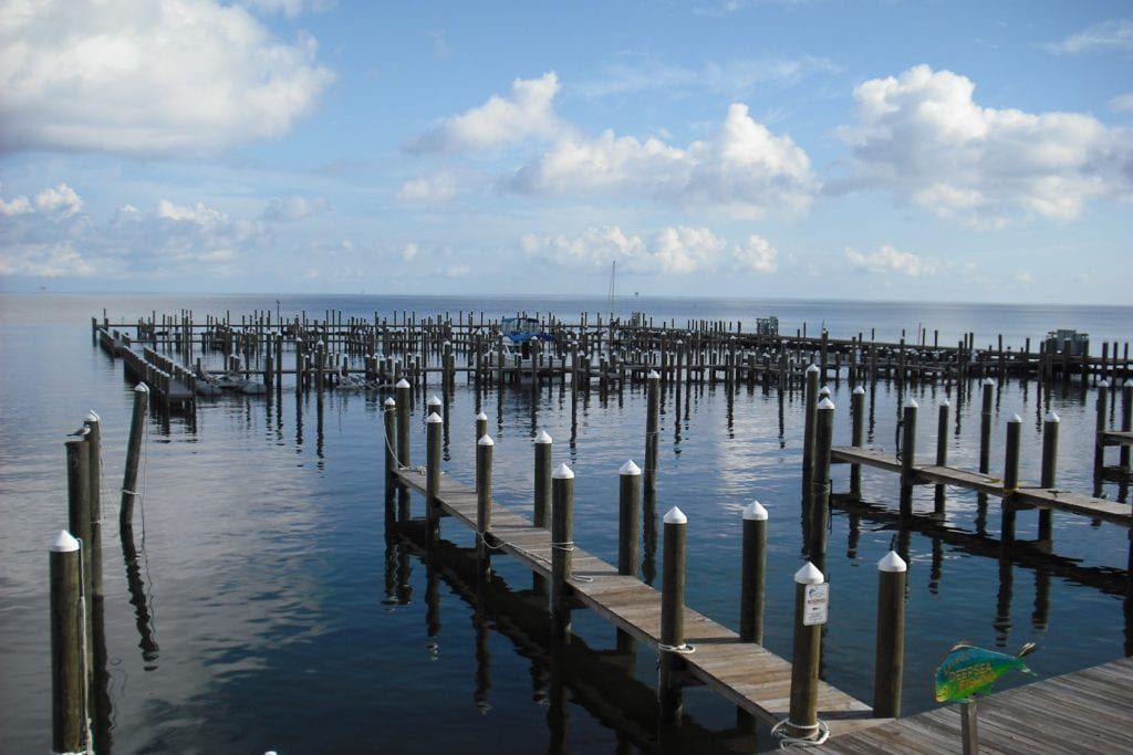 Mobile Bay in Mobile, Alabama with many wooden docks jutting into the water.
