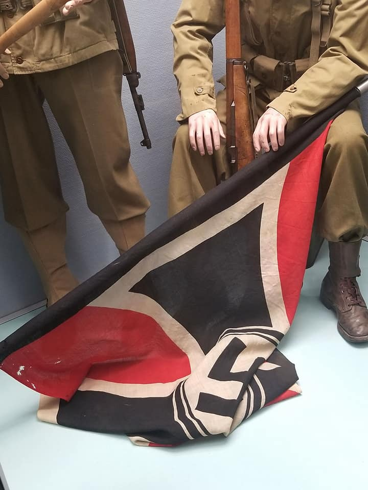 Old uniforms and flags from the war displayed in the Musee de la Reddition.