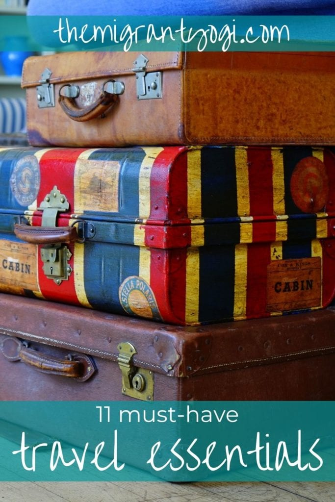 Pinterest graphic - stack of suitcases with text: 11 must-have travel essentials
