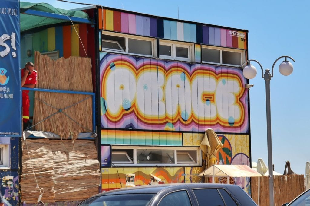 Building in Vama Veche with 'Peace' painted on the side
