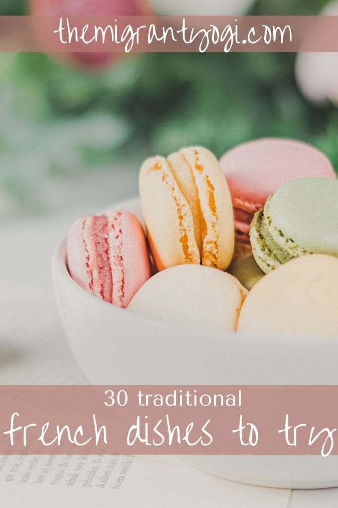Pinterest graphic showing pastel colored macarons with text: 30 traditional French dishes to try