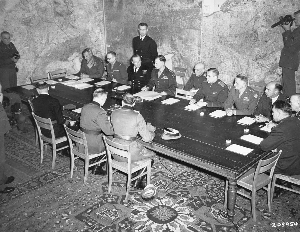 Original photo of General Jodl signing surrender at the first signing in Reims, 7 May 1945.