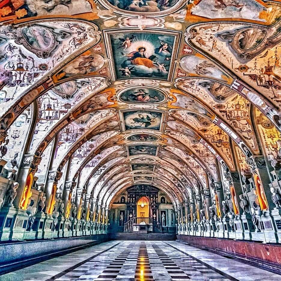Interior hall of Residenz in Munich, Germany in deep-jewel colors.