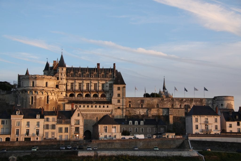Royal Chateau in Amboise, France under blue, semi-cloudy sky.