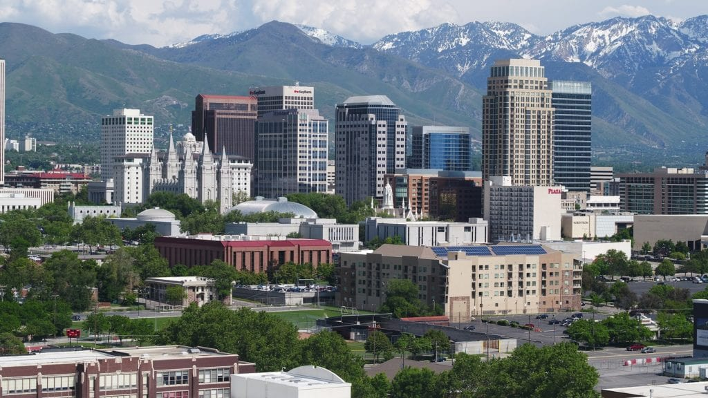 Snow covered mountains behind the landscape of Salt Lake City, Utah, one of the most underrated US cities