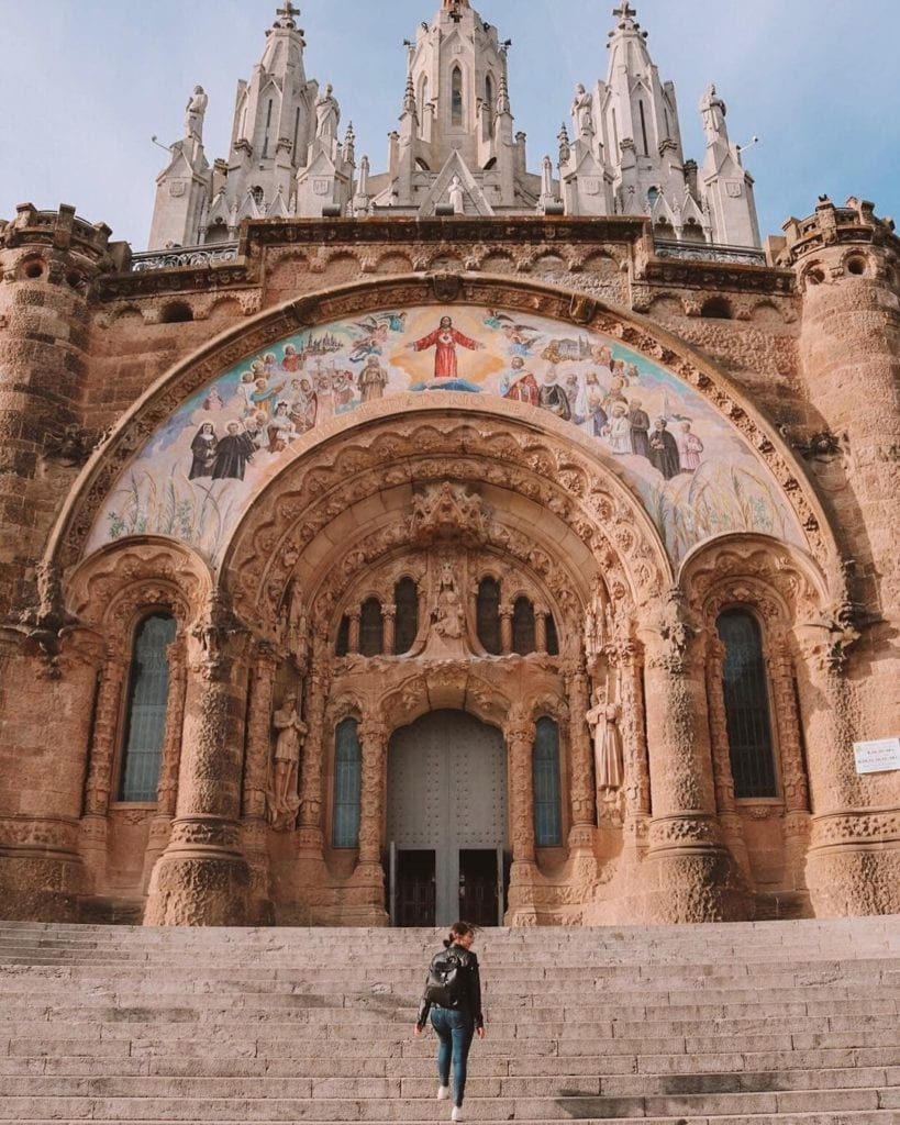 Woman ascending the steps up to Tibidabo church, one of the most beautiful places in Barcelona.