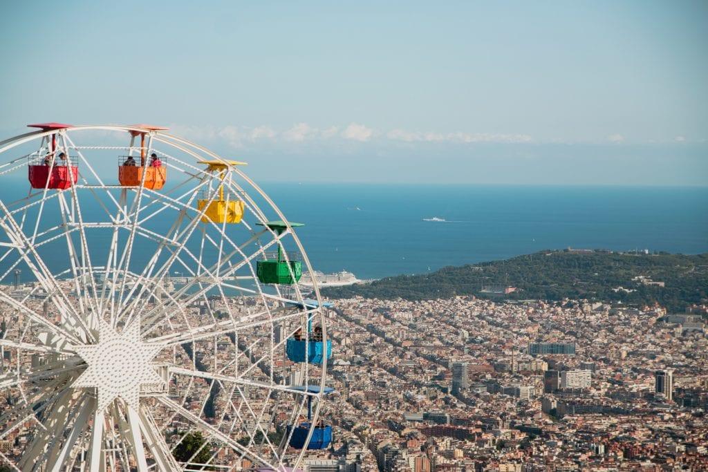 Rainbow ferris wheel at Mt. Tibidabo just outside Barcelona overlooking the Balearic Sea.