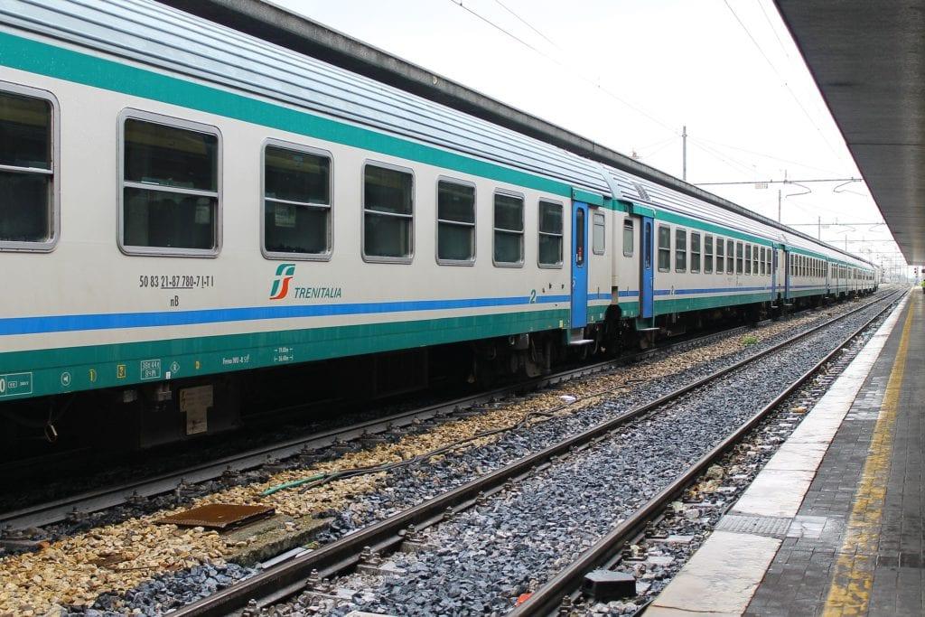 Trenitalia train shown on the tracks in Italy.