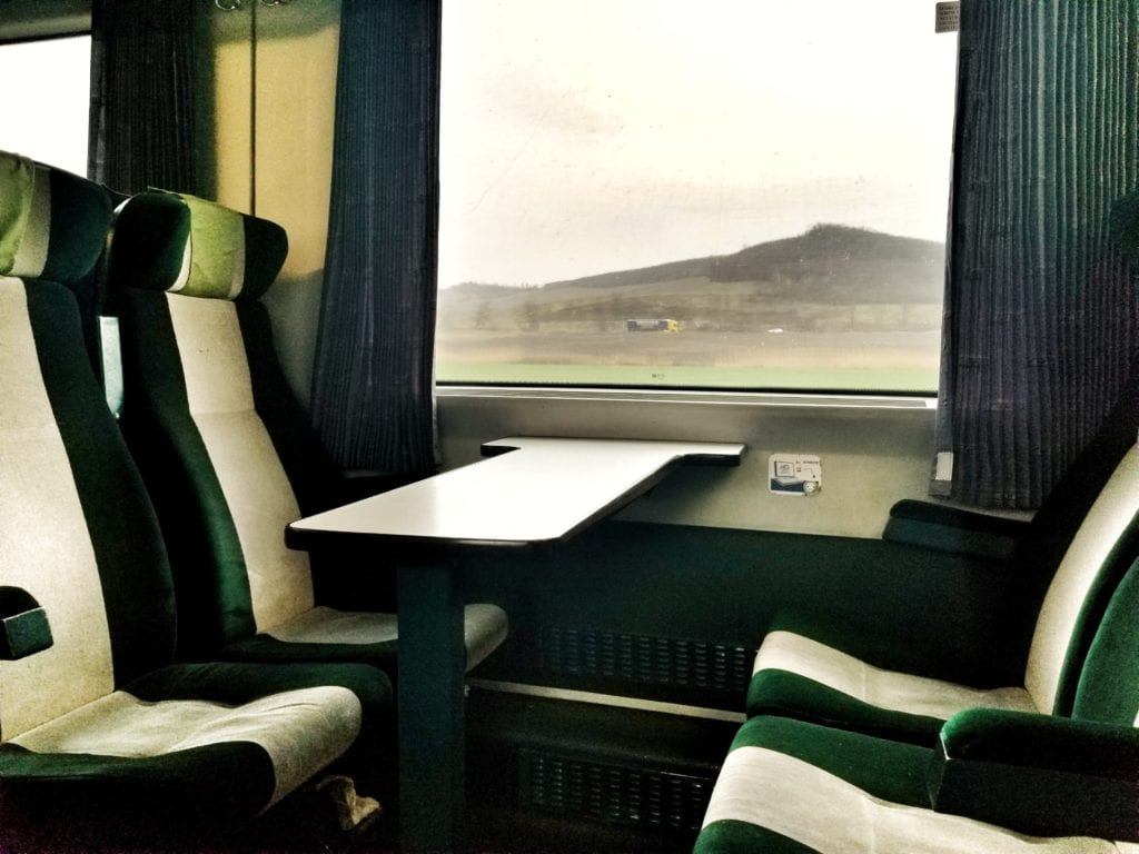 Interior of the train from Budapest to Sibiu showing a table and 4 seats.