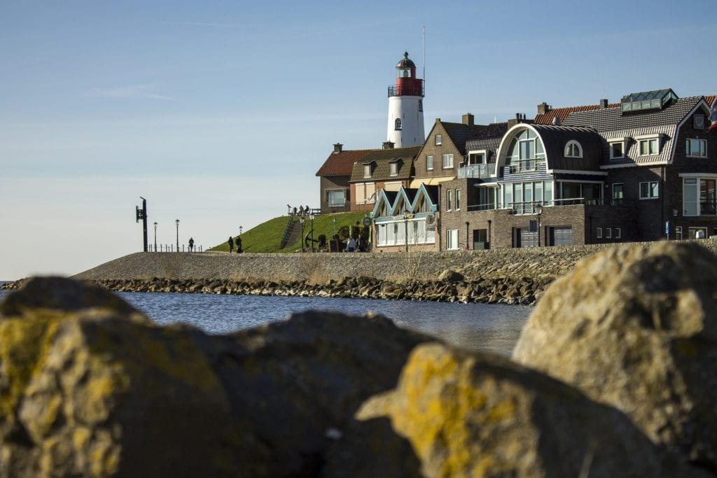 Coastal village in the Netherlands with a lighthouse in the background.