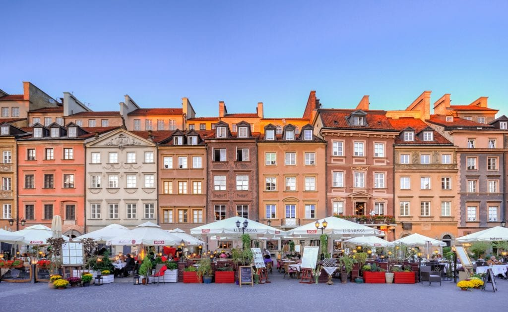 Warsaw Old Town with many stalls of vendors lining the street.