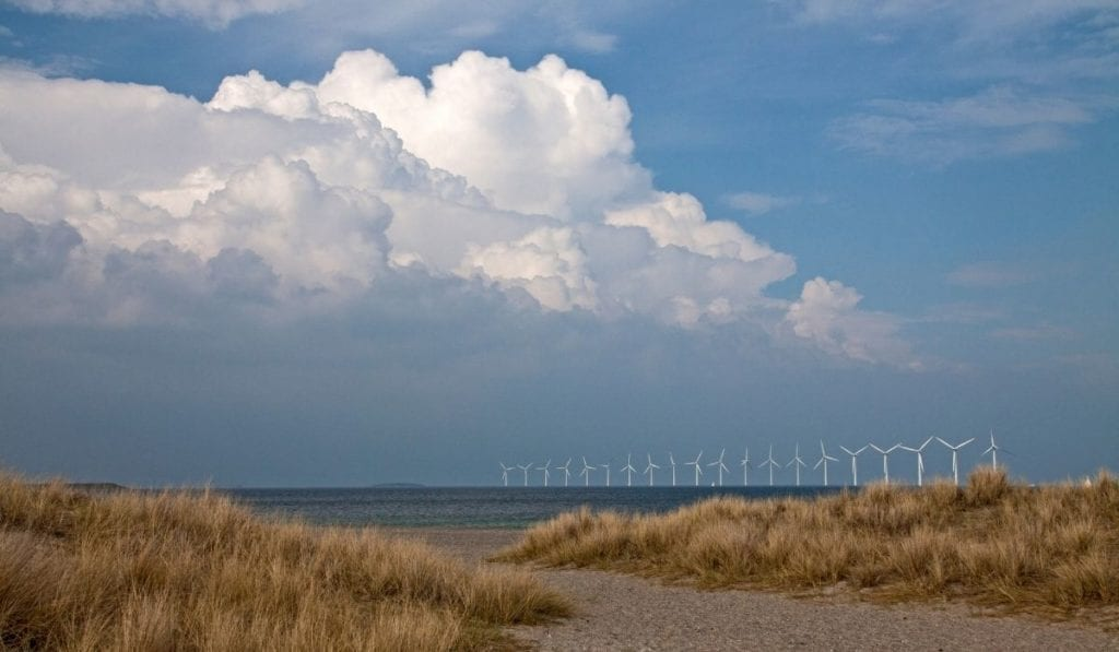 Amager Strand in Copenhagen is an underrated beach destination in Europe.  A long row of wind mills seen in the background.