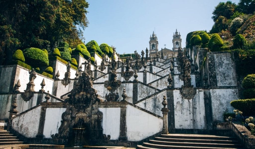 Iconic building in Braga, Portugal with tiered steps and surrounded by hedges.
