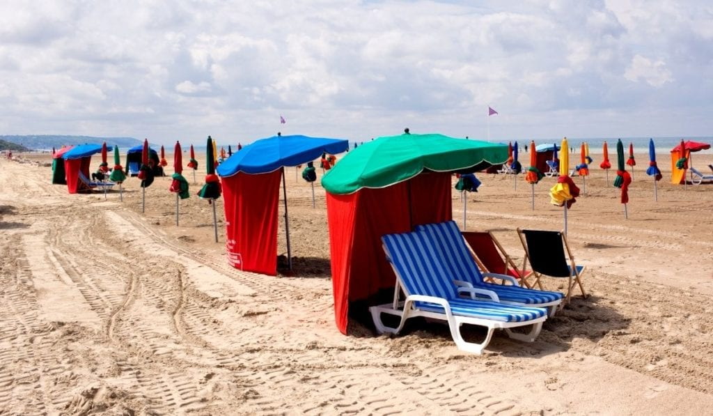 Beach chairs lined up on Deauville Beach in Normandy, France.