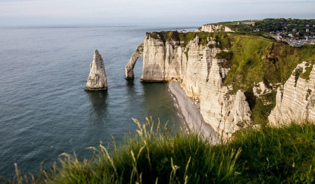 Etretat, a beautiful white cliff by the ocean in France.