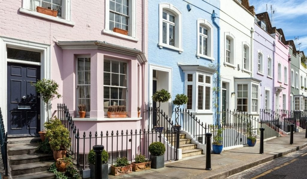 Row of pastel colored houses in London, UK, a surprising day trip from Paris.
